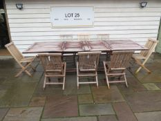 A second hand teak garden table extends from 180cm to 296cm x 110cm wide with eight folding teak