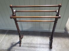 A Victorian mahogany towel rail - Height 87cm x Length 70cm - in good polished condition