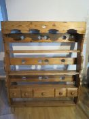 An ornate pine plate rack wall shelf with five small drawers incorporating old timbers - Height