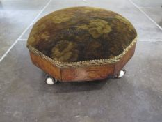 An early Victorian foot stool with ball and claw feet - some wear to fabric, wood in polished