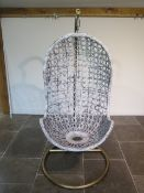 A repainted egg swing chair - Height 192cm
