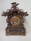 An unusual Cuckoo carved mantle clock, 46cm tall, in generally good condition, running order,