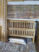 """An oak 5' double bed, headboard 42"""" tall"""