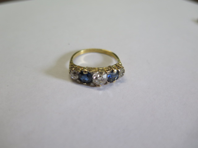 A late Victorian sapphire and diamond 'boat' style ring in yellow colour metal graduated six - Image 3 of 4