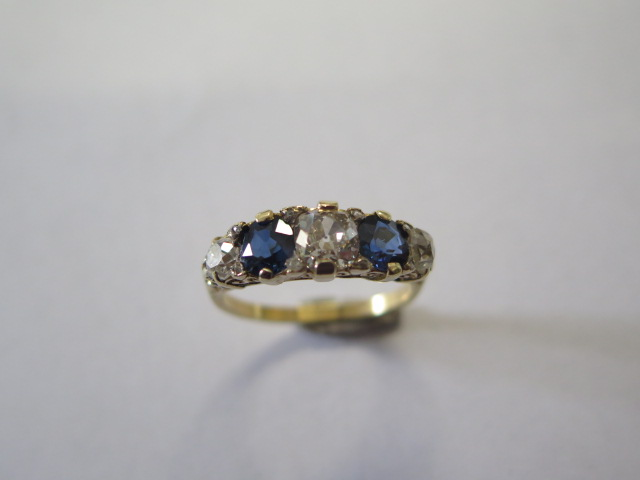 A late Victorian sapphire and diamond 'boat' style ring in yellow colour metal graduated six