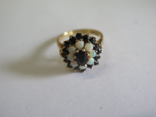 A hallmarked 9ct yellow gold opal and sapphire cluster ring, head 15mm wide, ring size O, approx 3.7 - Image 2 of 3