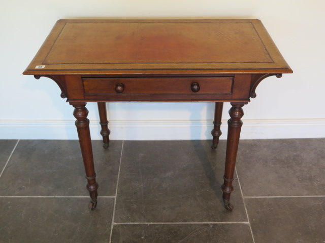 A Victorian mahogany side table with a single drawer and leather inset on top on turned legs, 73cm
