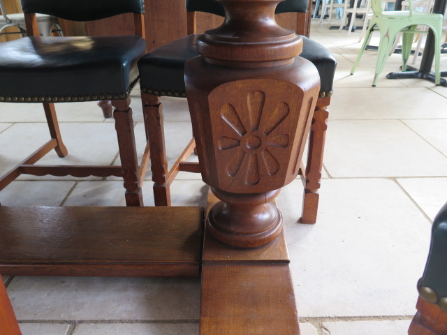 An oak refectory table on carved bulbous supports with 8 green leather upholstered chairs, 76cm tall - Image 2 of 3