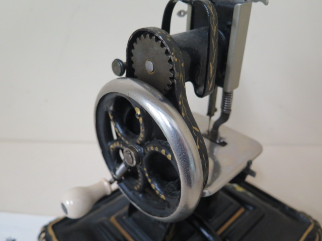 A Dorman lock stitch sewing machine, 22cm tall with stand, working and sympathetically repainted, - Image 5 of 5
