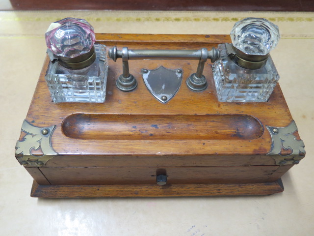 An oak desk stand with two bottles, replacement handle and one loose bottle top otherwise reasonably