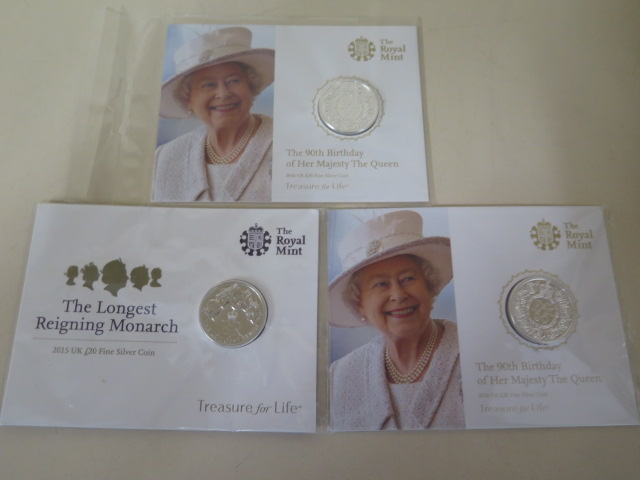 A pair of Royal Mint fine silver 2016 £20 coins and a fine silver 2015 £20 coin, all sealed