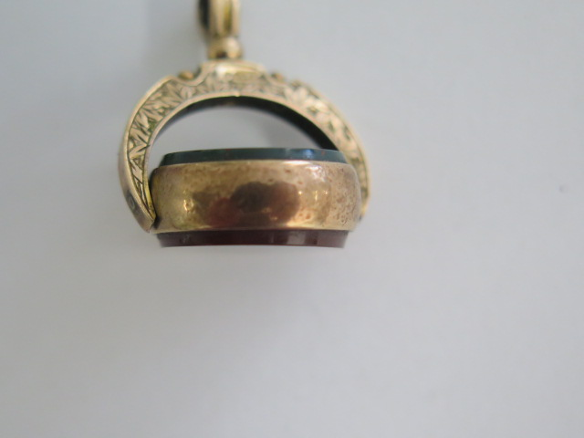A 9ct yellow gold swivel fob marked 9 375 in generally good condition, approx 5.4 grams, 22mm wide - Image 4 of 4