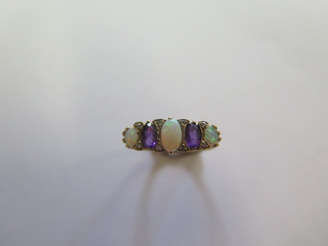 A hallmarked yellow gold opal, amethyst and diamond ring, size O, approx 2.6 grams in good condition