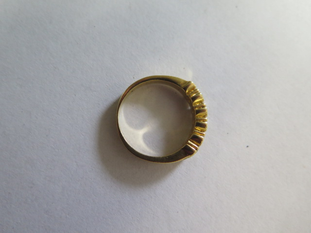 A diamond eternity ring in yellow colour metal, part hoop, comprising of five round brilliant cut - Image 3 of 3