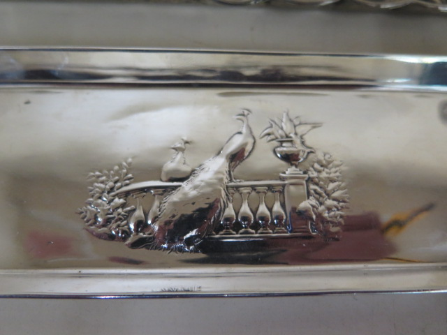 An ornate embossed silver plated tray 27cm x 19cm, a peacock embossed silver tray 18cm x 6cm - Image 2 of 6