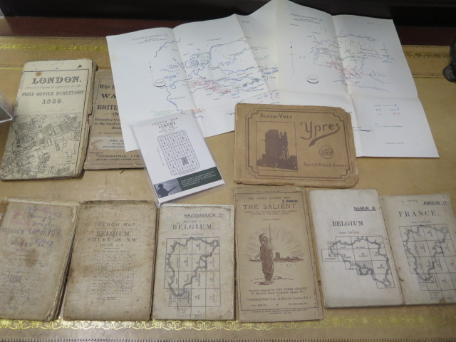 An interesting collection of five WWI trench maps, a reproduction map, an album of postcards Ypres
