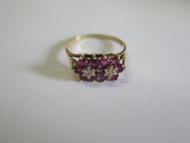 A hallmarked 9ct yellow gold diamond and ruby cluster ring, size U, approx 2.5 grams, in good