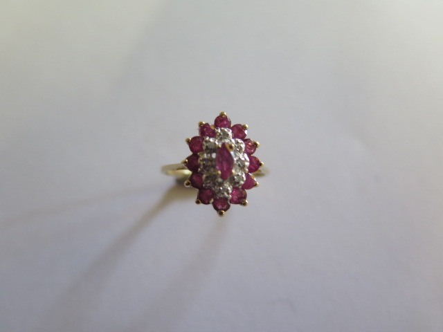A hallmarked 9ct ruby and diamond yellow gold cluster ring, size O, approx 3.3 grams in good