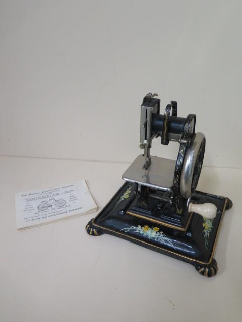 A Dorman lock stitch sewing machine, 22cm tall with stand, working and sympathetically repainted,
