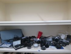 A collection of cameras and camera equipment including Olympus and Minox cameras, please see