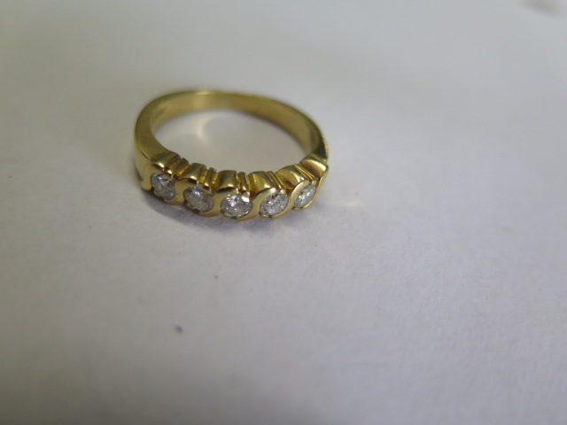 A diamond eternity ring in yellow colour metal, part hoop, comprising of five round brilliant cut - Image 2 of 3