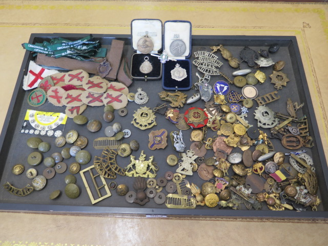 A collection of military buttons, badges, boy scout Glider patches Kings Own Regiment titles and