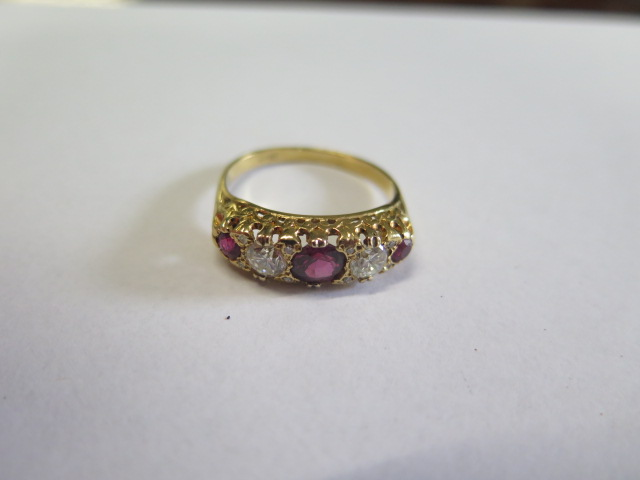 A ruby and diamond modern 'boat' ring in yellow colour metal, graduated size stones comprising of - Image 2 of 3