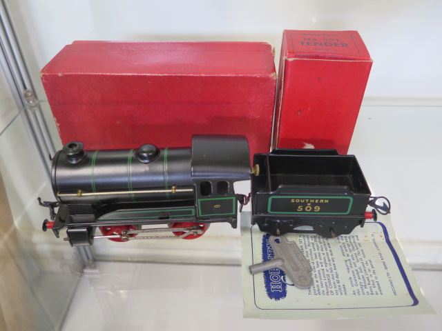 A boxed Hornby 0 gauge tin plate clockwork No 501 loco, tender has had replacement coupling