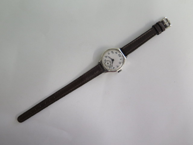 A silver case 1930s ladies wristwatch, has a CYMA 15 jewel lever movement with an enamelled dial,