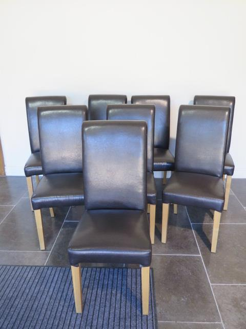 A set of eight modern brown faux leather effect high back dining chairs, 107cm tall