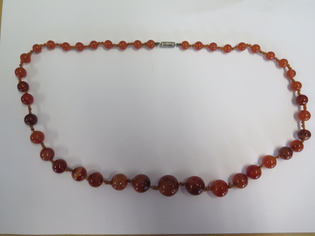 An agate necklace, 64cm long, largest bead approx 15mm, generally good condition, some wear to