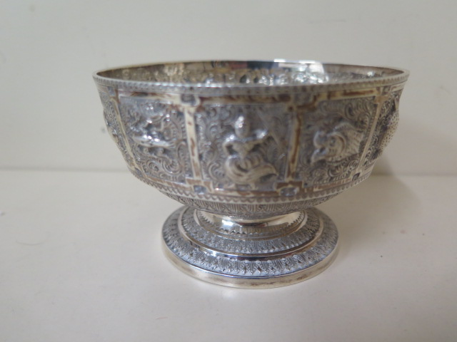 A silver embossed signs of the zodiac bowl, Edinburgh 1876/77 H&I Hamilton and Inches, 7cm tall x