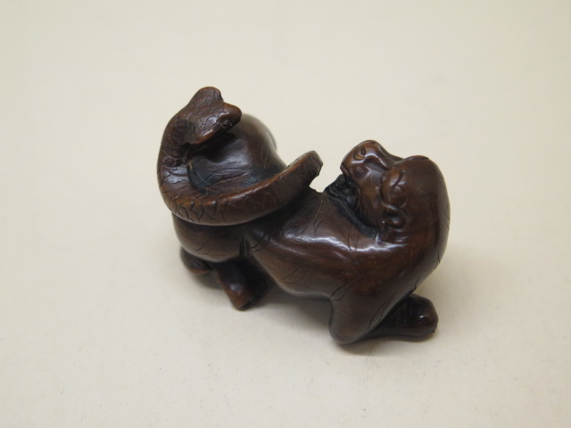Two carved wooden Netsukes of a lion and serpent, 4.5cm tall and a seated figure 3.5cm tall, both - Image 3 of 8