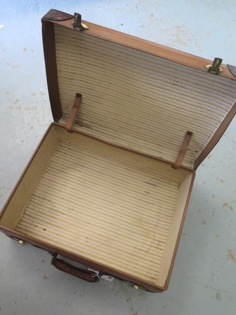 A Vintage fibre and leather suitcase with brass locks in good polished usable condition, 19cm x 56cm - Image 3 of 3