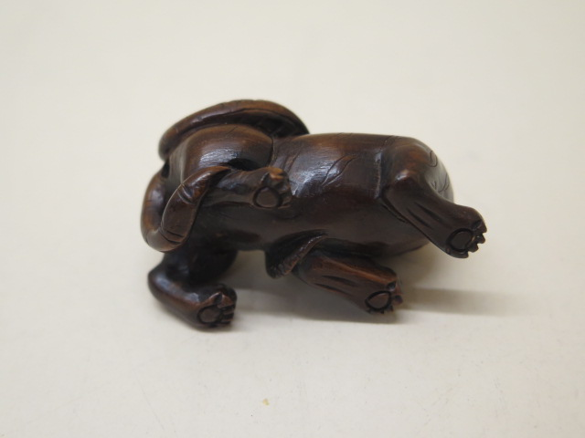 Two carved wooden Netsukes of a lion and serpent, 4.5cm tall and a seated figure 3.5cm tall, both - Image 4 of 8