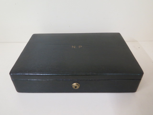 A Drew and Son early 20th century leather jewellery box with Braham lock, no key but good condition,