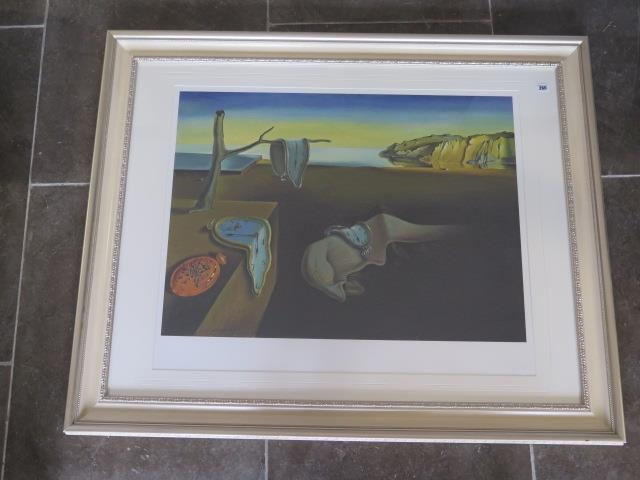 A limited edition gouttelette The Persistence of Memory by Salvador Dali, 33 of 75, in a silvered