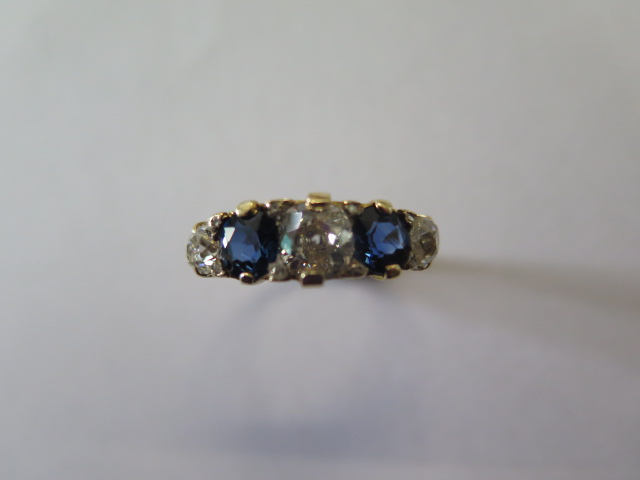 A late Victorian sapphire and diamond 'boat' style ring in yellow colour metal graduated six - Image 2 of 4
