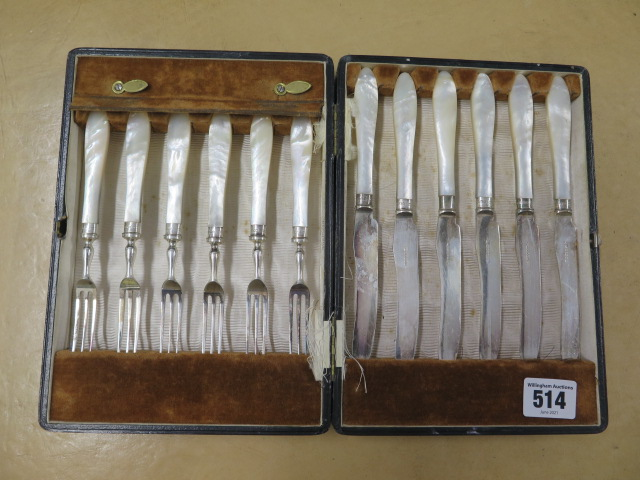 A set of six mother of pearl cake forks and knives with silver rims, one rim replaced but all good