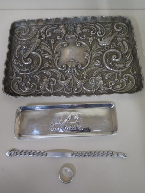 An ornate embossed silver plated tray 27cm x 19cm, a peacock embossed silver tray 18cm x 6cm