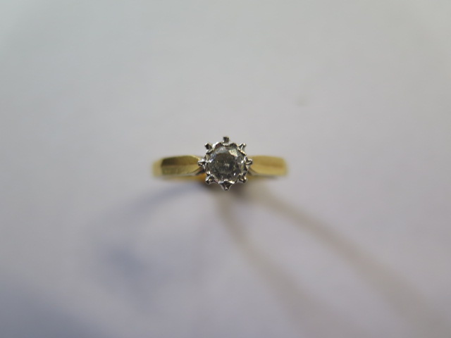 An 18ct diamond illusion set solitaire ring, size M, approx 3 grams, in good condition, marked 18ct