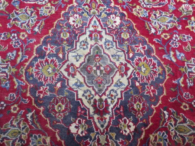 A rich red ground hand woven woollen full pile Persian Kashan carpet with traditional floral - Image 2 of 8