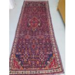 A rich blue ground full pile Persian hand woven Serouk woollen runner, 290cm x 112cm, in good