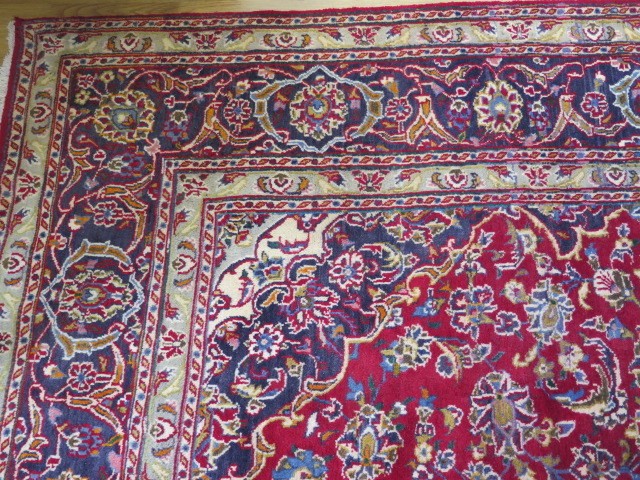A rich red ground hand woven woollen full pile Persian Kashan carpet with traditional floral - Image 6 of 8