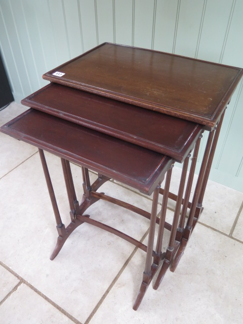 A nest of three mahogany side tables 68cm tall x 51cm x 34cm, repair to two legs otherwise generally