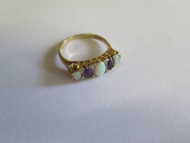 A hallmarked yellow gold opal, amethyst and diamond ring, size O, approx 2.6 grams in good condition - Image 2 of 3