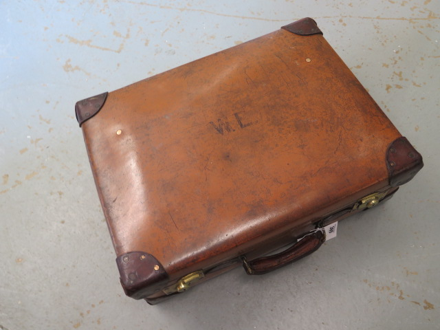 A Vintage fibre and leather suitcase with brass locks in good polished usable condition, 19cm x 56cm - Image 2 of 3