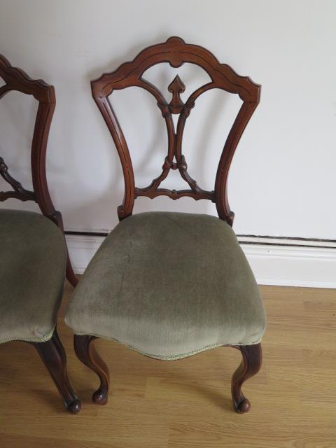 A set of four Victorian walnut side chairs with upholstered seats on cabriole shaped front legs, all - Image 2 of 2