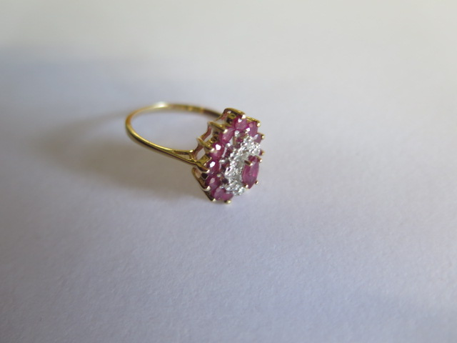 A hallmarked 9ct ruby and diamond yellow gold cluster ring, size O, approx 3.3 grams in good - Image 2 of 3