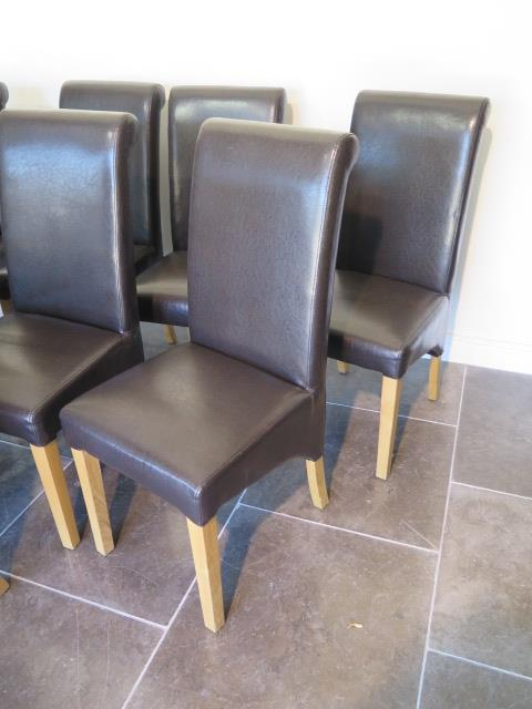 A set of eight modern brown faux leather effect high back dining chairs, 107cm tall - Image 2 of 2